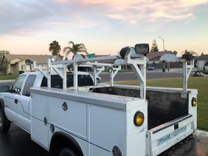 Nice heavy duty ladder rack with lights and spots for cords and hoses for Sale in Bakersfield, CA