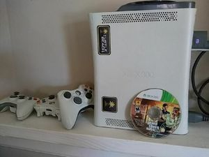 Xbox 360 with controllers and tons of games for Sale in Columbus, OH