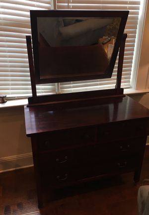 Antique dresser from 1912. Keyhole locks. Key included for drawers. Indiana manufacturing company. Price is negotiable. Very sturdy. On wheels. for Sale in Tampa, FL
