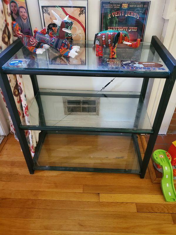 Metal frame with glass shelves
