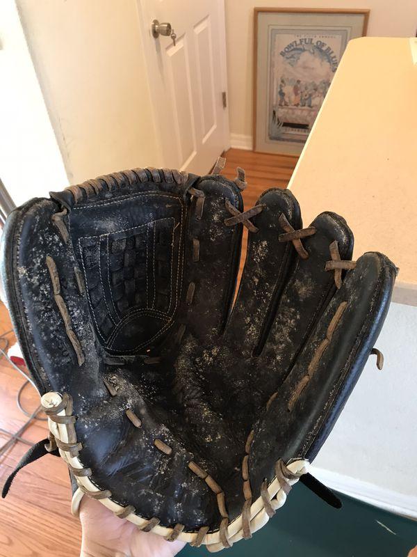 2 Baseball Gloves With Baseball
