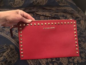 Michael Kors bad wristlet clucth for Sale in San Francisco, CA