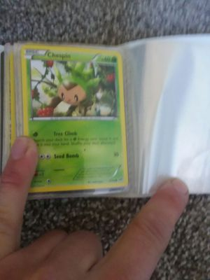 Pokemon cards and pokemon card holder for Sale in Delta, CO