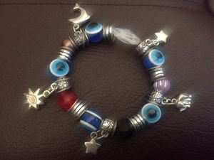 Evil eye stone and charm bracelet, fits all for Sale in Northbrook, IL