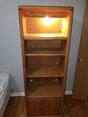 4 shelf wooden bookcase with light and bottom cabinet for Sale in Denver, CO