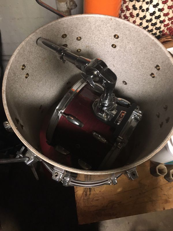 Pearl drum set with extra hardware.