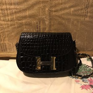 IUC Gorgeous H BLACK AND GOLD TONE SHOULDER BAG WITH H GOLD TONE FLAP BUTTON CLOSURE. for Sale in E ATLANTC BCH, NY