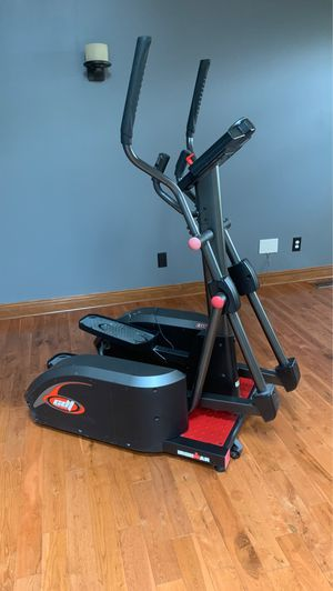 Elliptical one side is cracked however it works like brand new. My husband was standing a a chair and he fell right on top of it. Got it from Costco for Sale in Dearborn Heights, MI