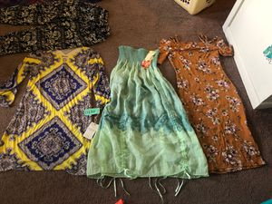 One dress is one size fits all . Then the brown is med .And the yellow with purple it Petite for Sale in Germantown, MD