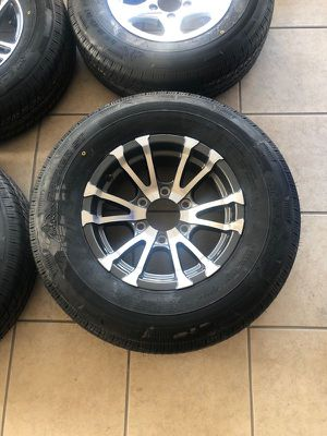 "15"" 6 lug aluminum rim and tire - Trailer tires - New radial 225/75/15 - we install for free - We carry all trailer tires and trailer parts for Sale in Plant City, FL"