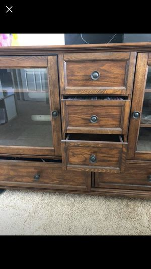 World Market entertainment console. Used for Xbox, cable box storage. 2 drawers at the bottom. 3 drawers in the middle. 2 glass doors with 2 shelves for Sale in Naples, FL