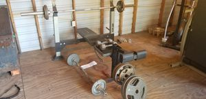 Weight bench, curlbar, barbell, dumbbells, and weight plates for Sale in Houston, TX