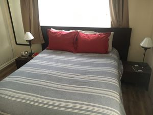 Queen wood bed frame, side tables, and box spring for Sale in West Palm Beach, FL