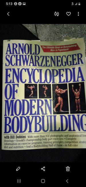 ARNOLD SCHWARZENEGGER ENCYCLOPEDIA OF MODERN BODY BUILDING BOOK $10. for Sale in Plano, TX