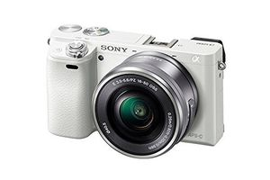 Sony Alpha a6000 Mirrorless Digital Camera with 16-50 mm Lens 24.3MP (Silver) BRAND NEW for Sale in Garden Grove, CA