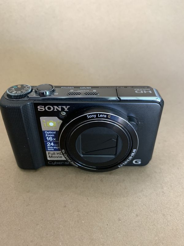 Sony dsc-hx9v Cyber-shot camera with special bracket that holds the camera and lens. 3 battery's & charger 2 lenses