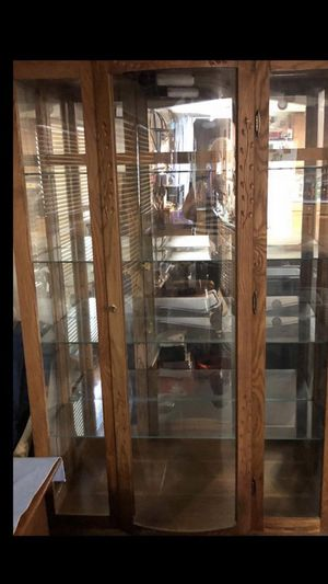 Curio cabinet 4 glass shelves and light you pick up for Sale in Jackson, OH