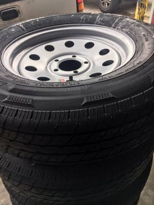 """set of 4 - Trailer tires 205/75/15 - 15"""" 5 Lug Trailer tires - Radial on silver mod - Tire and Rim - free installation - we carry all trailer tires for Sale in Plant City, FL"""