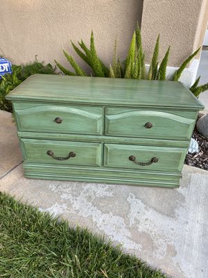 Selling a small vintage solid wood low profile 4 drawer dresser/TV stand , in good solid condition for Sale in Silverado, CA