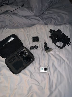 GoPro hero 4 w/ 2 extra batteries and some accessories for Sale in Oviedo, FL