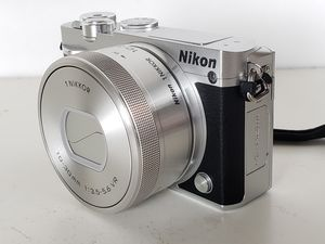 Nikon 1 J5 20.8MP Mirrorless Camera Body with 10-30mm VR Lens like New for Sale in Oakland, CA