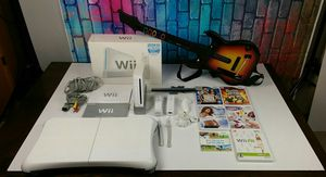 Nintendo Wii Sports Bundle Pack w/ Guitar Hero and Guitar and Balancing Board For Wii Fit for Sale in Grand Prairie, TX