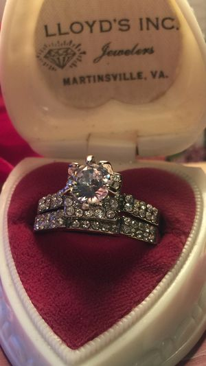 Beautiful engagement ring set channel set sapphires on two bands with raised square center with round larger sapphire on sterling silver plated band for Sale in Northfield, OH