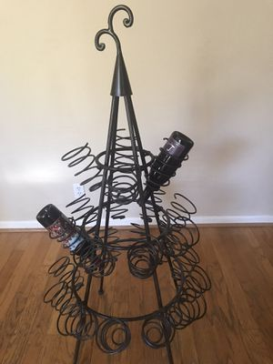 Rod iron wine rack from Pier One. Holds 24 bottles. Perfect Condition. for Sale in Roseville, CA