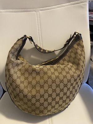 Authentic Gucci studded half moon hobo monogram gg shoulder bag for Sale in Greenwood, IN