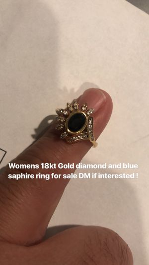 Women 18kt gold ring with genuine diamonds and dark blue sapphire for Sale in Silver Spring, MD