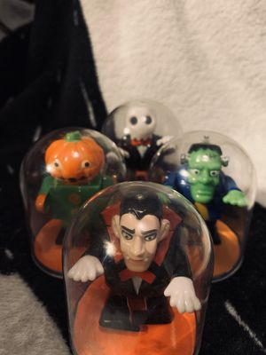 Halloween monsters collectable wind up toys in protective cases. for Sale in Denver, CO