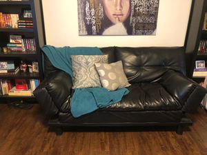 Black leather futon couch for Sale in Los Angeles, CA