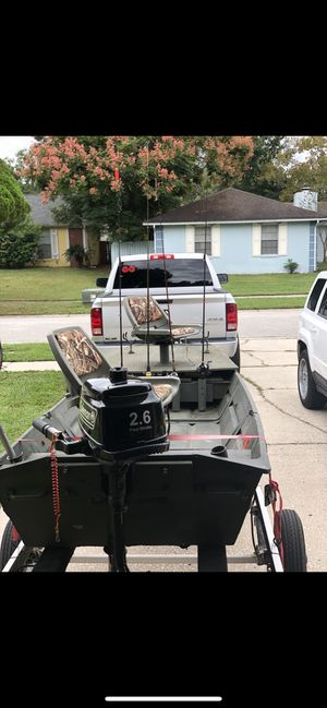 14 foot John boat with trailer and 4 stroke 2.6 Coleman outboard for Sale in Valrico, FL
