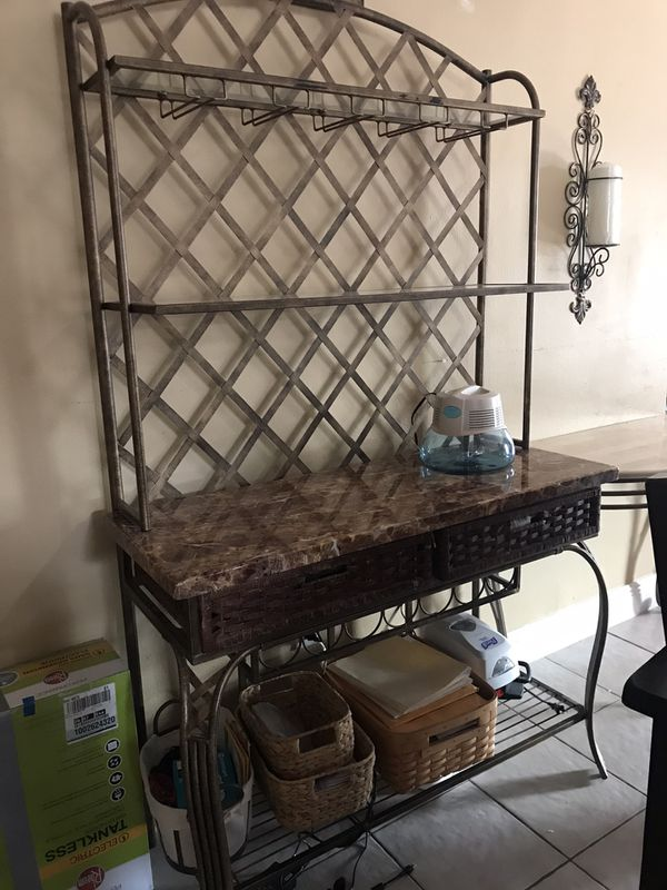 Iron and granite bar! Holds seven bottles in bottle rings, very well kept, originally cost $750 from Rooms to Go , asking price $250 ( only serious i