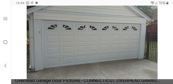 Garage door raised panel with sunburst windows
