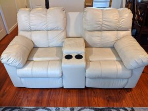 Ashley Furniture Leather Power Recliners Loveseat with console cream color for Sale in Castro Valley, CA