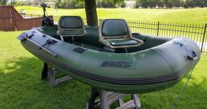 Inflatable boat with motor and Marine battery ($1750 value, brand new used once) for Sale in Houston, TX