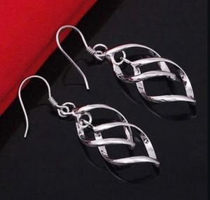 Spiral Silver Plated Drop Earrings for Sale in Houston, TX