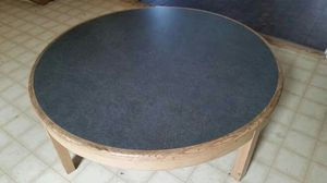"48"" round coffee table. Sits 16"" high and is sturdy. Greenstone formica top and light oak base. for Sale in Red Oak, TX"
