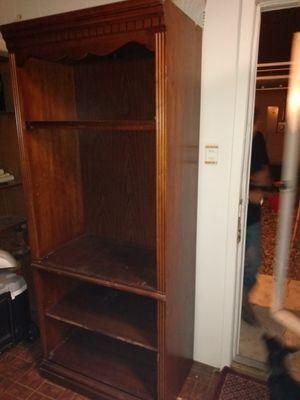 Wood shelving unit with overhead light illuminating top shelf for Sale in Abilene, TX