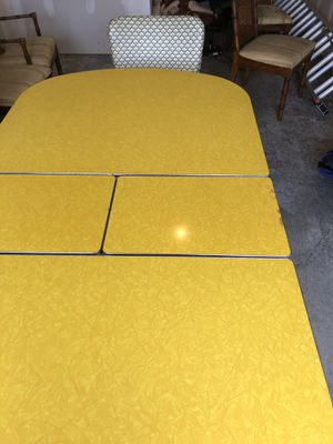 Antique antique table.Retro table metal legs 4 Chairs reupholstered leave in the middle falls underneath the table old good condition can deliver if for Sale in Camano, WA