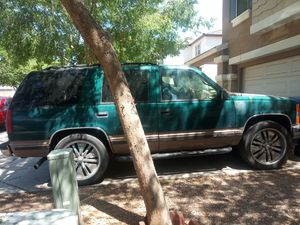 1995 Chevy Tahoe..honesly when it got a problem i just decided to get a car that 4 my babies 4 car seats.dent in 1 door Take it with the rims & tires for Sale in Mesa, AZ