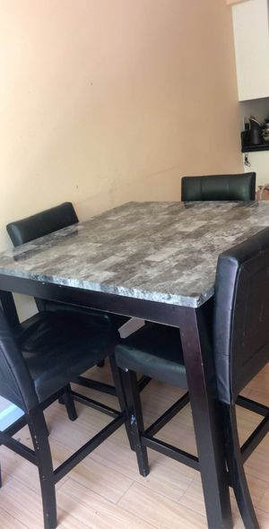 High top table with 4 chairs. In a used condition with few stains and pilings. for Sale in Los Angeles, CA