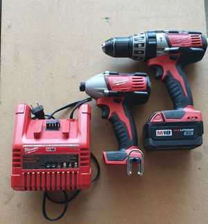 Milwaukee m18 1/2 hammer drill and impact driver combo comes with red lithium xc battery and charger for Sale in Los Angeles, CA