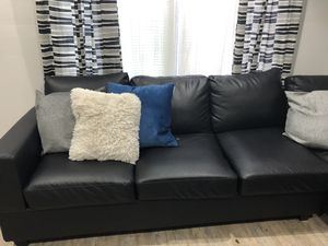Black Leather Sectional couch including ottoman for Sale in Tampa, FL