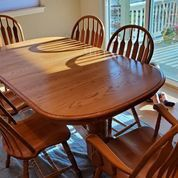 Solid Oak Dining Table with two leaves and 6 chairs (2 captain) for Sale in Aurora, CO