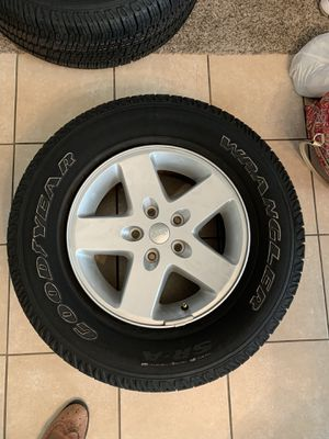 2007-2017 Jeep Wrangler OEM Wheels And Tires Goodyear P255/75R17 for Sale in Grand Prairie, TX