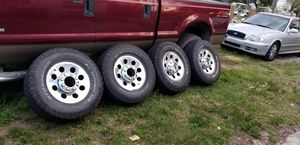Polished aluminum wheels and tires with center caps and lug nuts off of a 2006 f250 4x4 for Sale in Frostproof, FL
