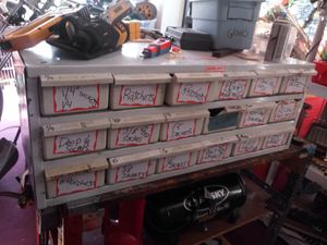 Metal organizer with plastic drawers weatherproof comes with 18 drawers very deep can fit a hammer for Sale in Cleveland, OH