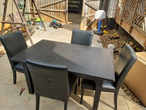 Heavy solid wood table with leaf and 4 plush chairs for Sale in Greenville, SC